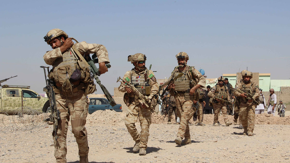 In this photograph taken on October 9, 2016, Afghan National Army commandos take position during a military operation in Helmand province.