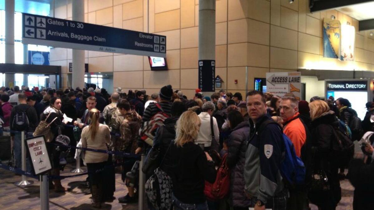 Travelers waiting in line at Bradley Airport