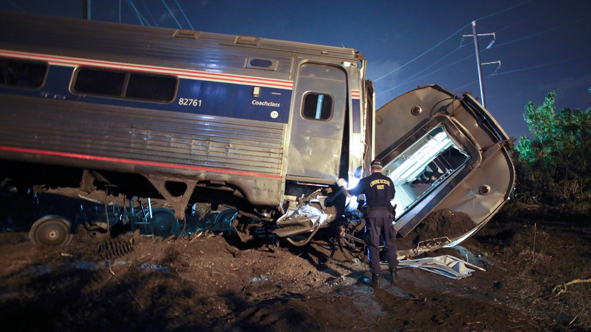 Emergency personnel work the scene of a deadly train wreck, Tuesday, May 12, 2015, in Philadelphia, where an Amtrak train headed to New York City derailed. Eight people died and hundreds were injured.