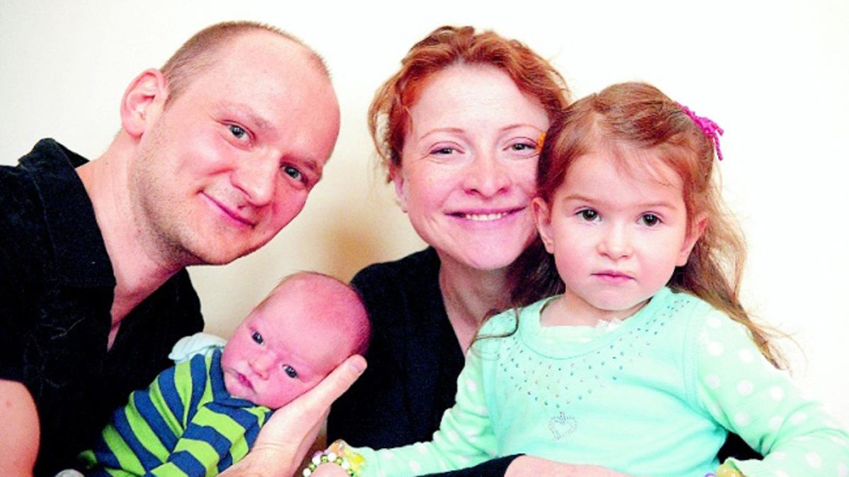 Sergei Rubinstein with newborn Damien, and Anna Rubinstein holding 3-year-old daughter Danica. Anna Rubinstein went into labor at a North Jersey nail salon.