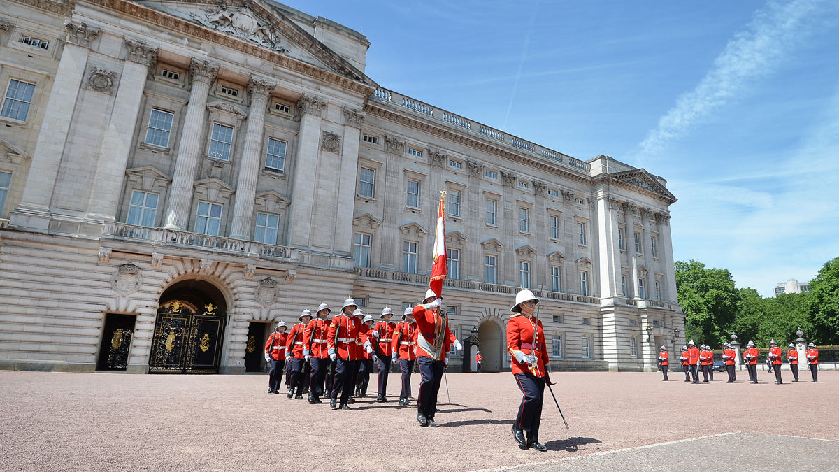 Captain Megan Couto, front, makes history as she becomes the first woman to command the Queen's Guard at Buckingham Palace on June 26, 2017 in London.