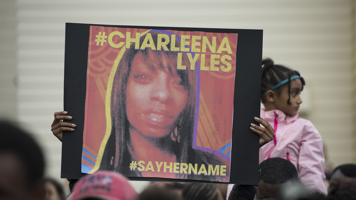 A woman holds a sign in honor of Charleena Lyles during a protest and rally in honor of Lyles on Tuesday, June 20, 2017, in Seattle. Officers from the Seattle Police Department shot and killed Lyles, a pregnant mother of four, on June 18.