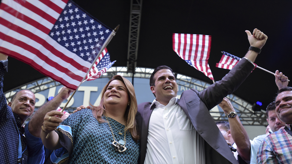 In this June 11, 2017 file photo, Governor Ricardo Rossello, right, celebrates the results of a referendum on the status of the island in San Juan, Puerto Rico. The governor is pushing for statehood amid the territory's debt crisis.