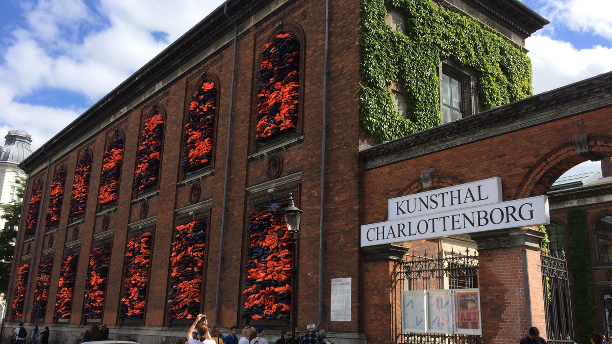People view the new artwork by Chinese dissident artist Ai Weiwei, entitled 'Soleil Levant,' at Kunsthal Charlottenborg museum in Copenhagen, Denmark, Tuesday June 20, 2017. Weiwei has barricaded the windows of the museum for his provocative new artwork as a striking reminder of the ongoing migrant crisis, inaugurated Tuesday on World Refugee Day.