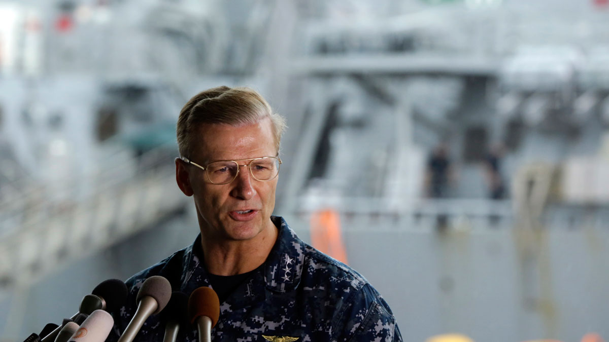 In this Sunday, June 18, 2017 file photo, Vice Adm. Joseph Aucoin, Commander of the U.S. Navy's 7th Fleet, speaks during a press conference.