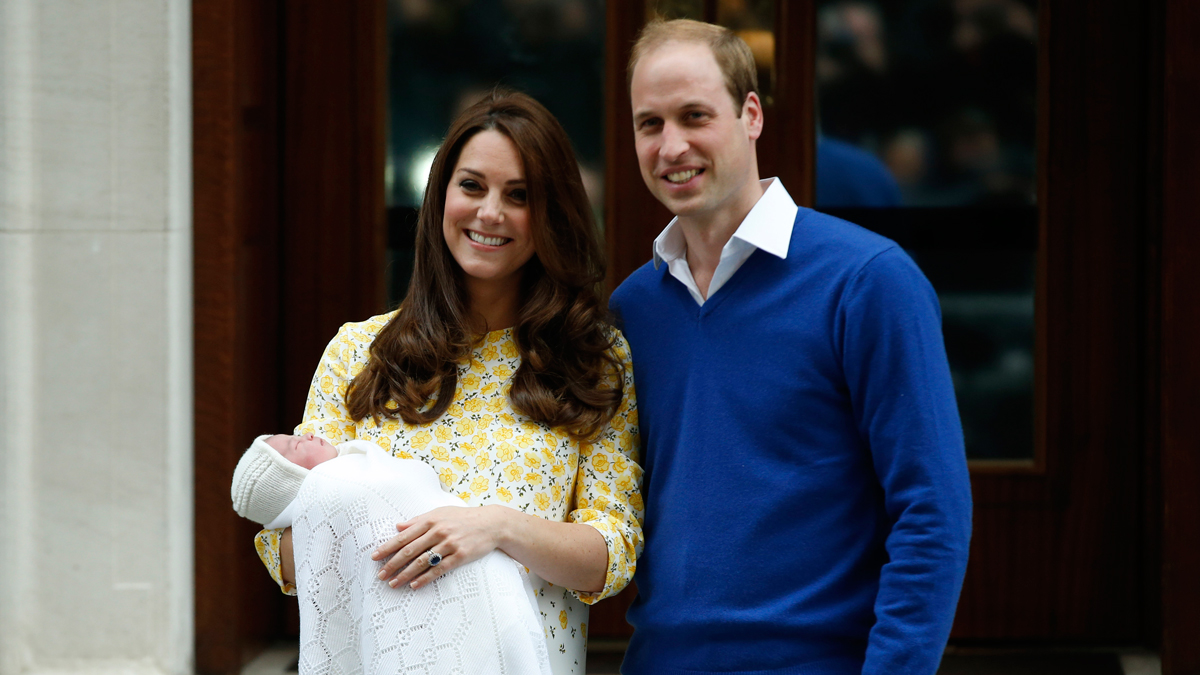 Britain's Prince William, right, and Kate, Duchess of Cambridge, hold their newborn daughter as they pose for the media outside the St. Mary's Hospital's exclusive Lindo Wing, London, Saturday, May 2, 2015. The Duchess gave birth to the Princess on Saturday morning.
