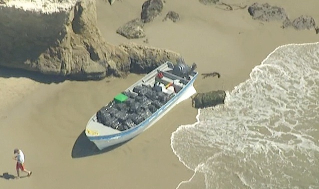 A boat carrying bundles of marijuana washed ashore Monday April 7, 2014 west of Malibu.