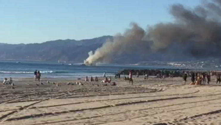 Five adults and one baby were unharmed when a boat caught fire in the waters off Marina Del Rey Saturday, Nov. 21, 2015.