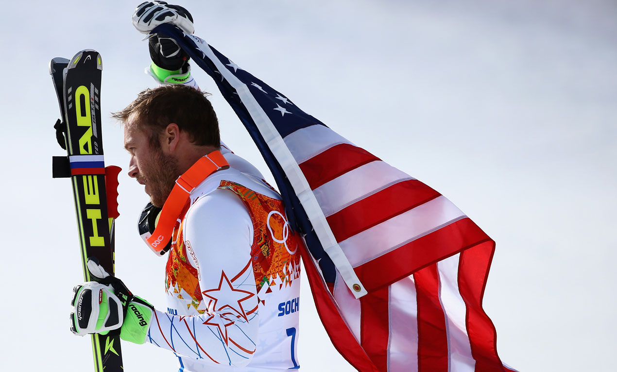 Bronze medalist Bode Miller of the United States reacts during the flower ceremony for the Alpine Skiing Men's Super-G on day 9 of the Sochi 2014 Winter Olympics at Rosa Khutor Alpine Center on February 16, 2014 in Sochi, Russia.