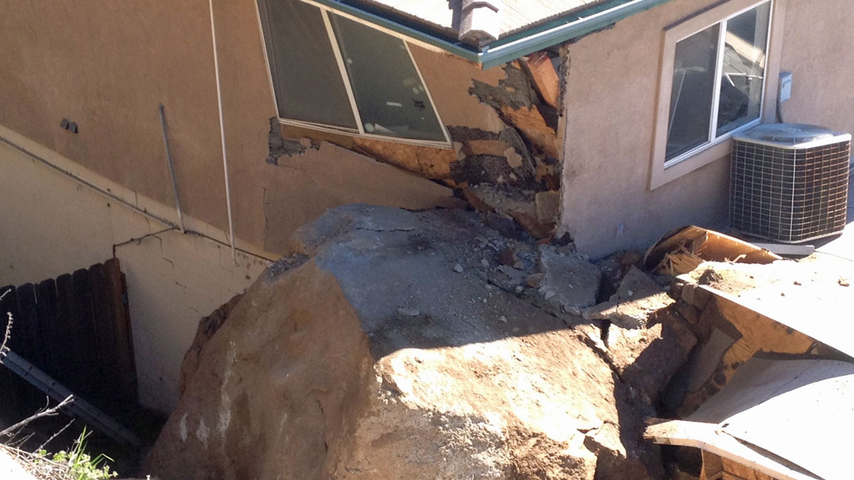 A closer look at the damage caused by the large rock.