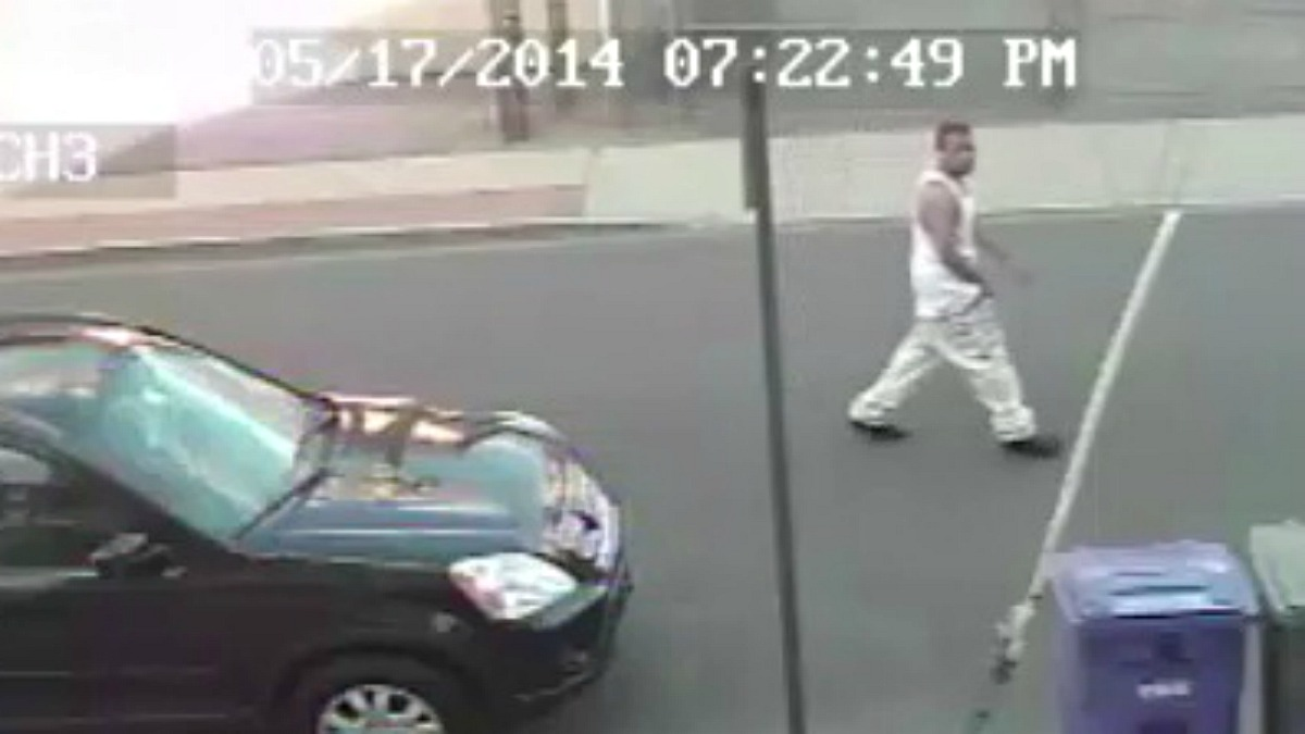 Bridgeport police are searching for the man who shot at a parked car in the city's East End last month.