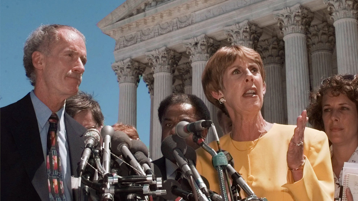 Sarah Brady talks during a news conference Friday, June 27, 1997, in Washington, while Chief of Police Mike Chitwood, Portland, Maine, listens at left.  The Supreme Court struck down a key part of the Brady gun-control law, saying the federal government cannot compel local police to determine if buyers were fit to own handguns.