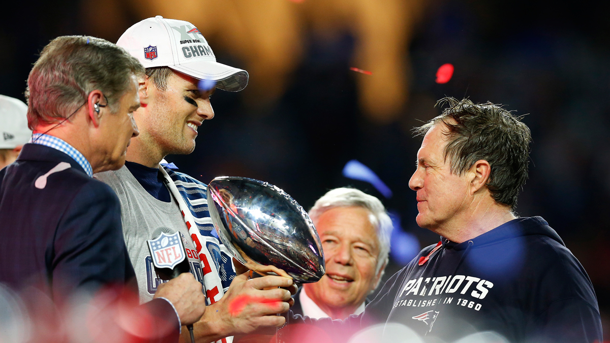 Tom Brady, team owner Robert Kraft, and head coach Bill Belichick of the New England Patriots celebrate with the Vince Lombardi Trophy after defeating the Seattle Seahawks 28-24 to win Super Bowl XLIX on February 1, 2015.