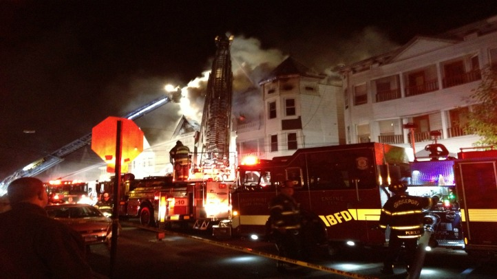 Fire officials said a rookie Bridgeport firefighter lives in one of the buildings and was first to smell the smoke.