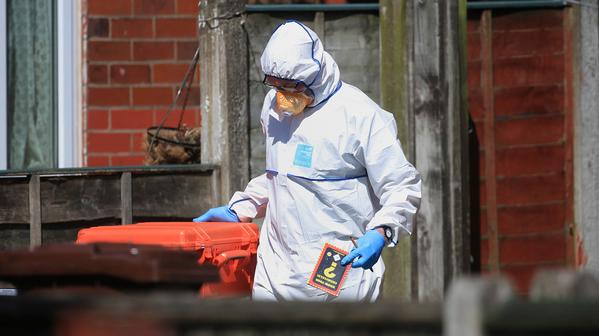 Police forensic investigators search the property of Salmon Abedi in connection with the explosion that took place at the Manchester Arena, in Greater Manchester, England, Tuesday, May 23, 2017. Official records show that Salmon Abedi was registered as living at the Manchester house raided by armed police investigating Monday night's deadly concert blast. The electoral register shows that Abedi - named by U.S. officials as the suspect in the suicide bombing at an Ariana Grande concert - lived at the house in Fallowfield in southern Manchester where police carried out a controlled explosion Tuesday.