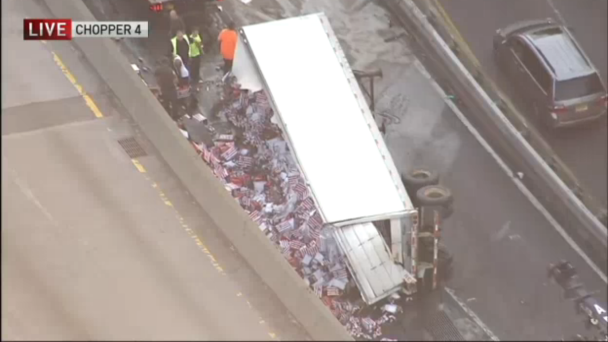A Budweiser truck overturned in Brooklyn, New York on Aug. 8, 2016, injuring one man and disrupting traffic on a busy roadway during the morning rush.