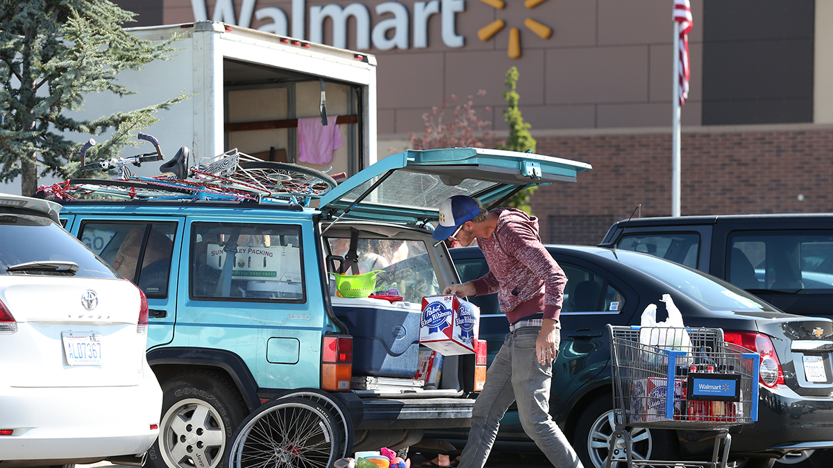 Burner Jake Pickle, of Encinitas, Ca., stocks up Tuesday morning, Aug. 26, 2014, at a Wal-Mart in Reno, Nev., after a rare rain storm temporarily closed the entrance to Burning Man yesterday. The Playa reopened at 6 a.m. for the week-long counter-culture festival that draws 70,000 people to the Black Rock Desert.