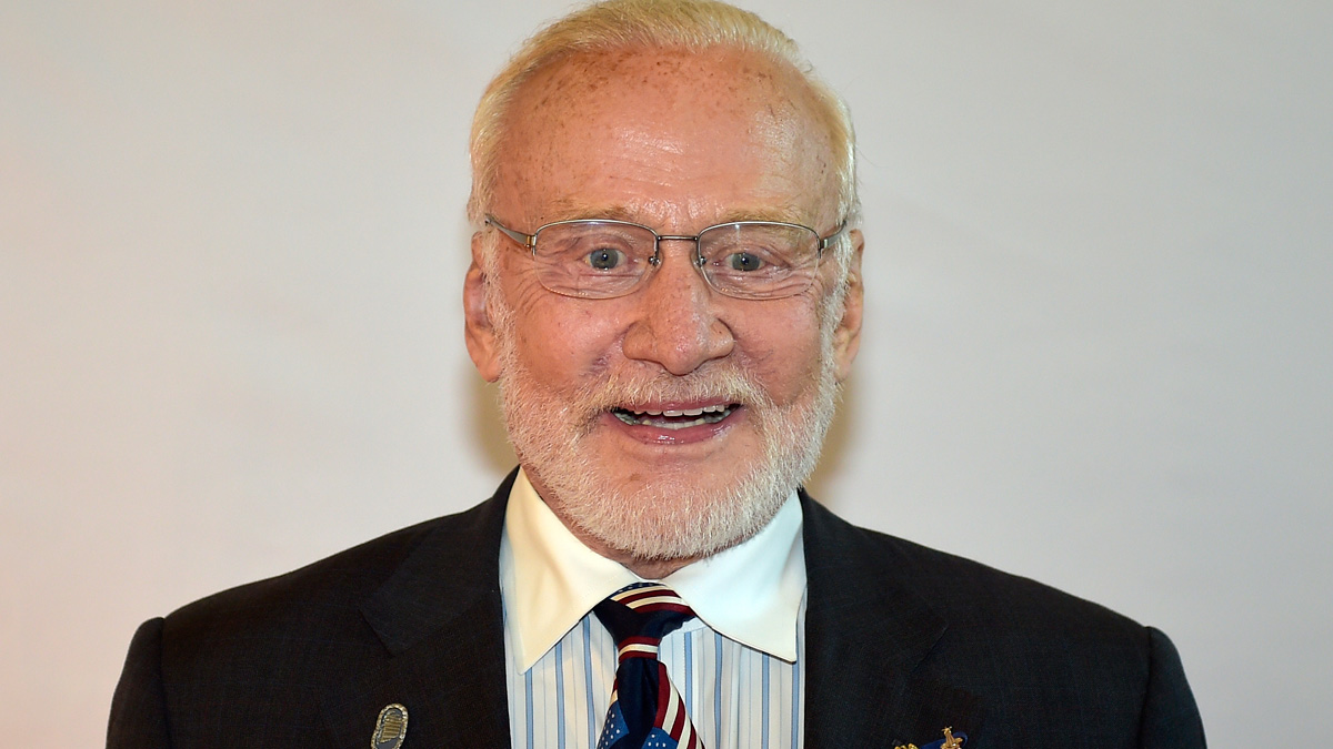 In this file photo, US astronaut legend Buzz Aldrin poses for photographers on the red carpet at the Steiger Award Ceremony in Hattingen, Germany, Friday, Oct. 3, 2014.