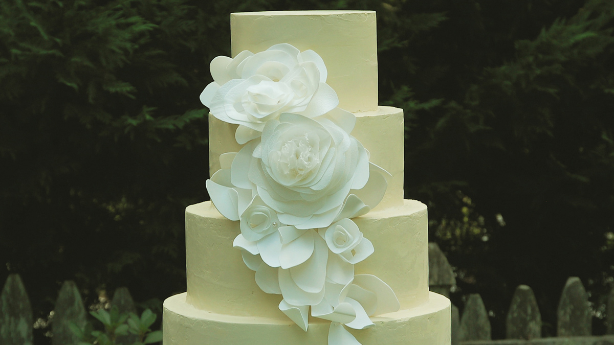 In this undated publicity photo provided by Lauren Karnitz Studio, a White Petal Cascade Cake is shown in Knoxville, Tenn.