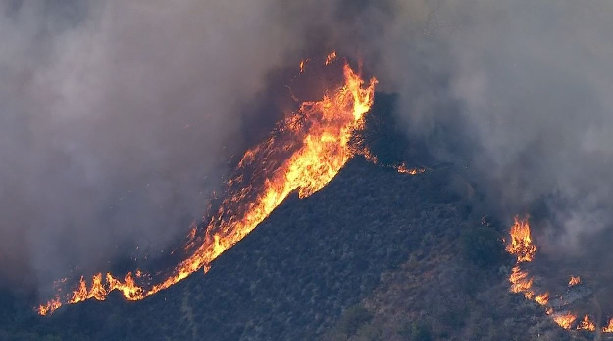 A third-alarm brush fire raged in the Calabasas area close to homes Saturday, June 4, 2016.
