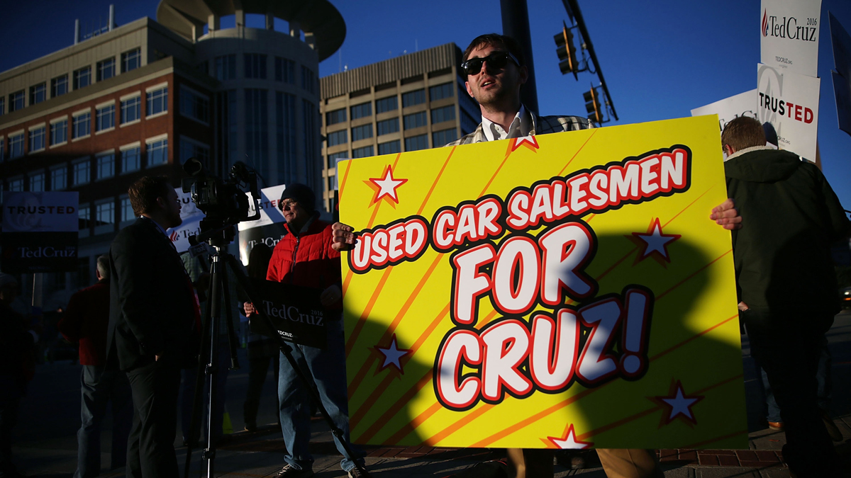 A man holds a sign in front of supporters of Republican presidential candidate Sen. Ted Cruz (R-TX) prior to a CBS News GOP Debate February 13, 2016 outside the Peace Center in Greenville, South Carolina.