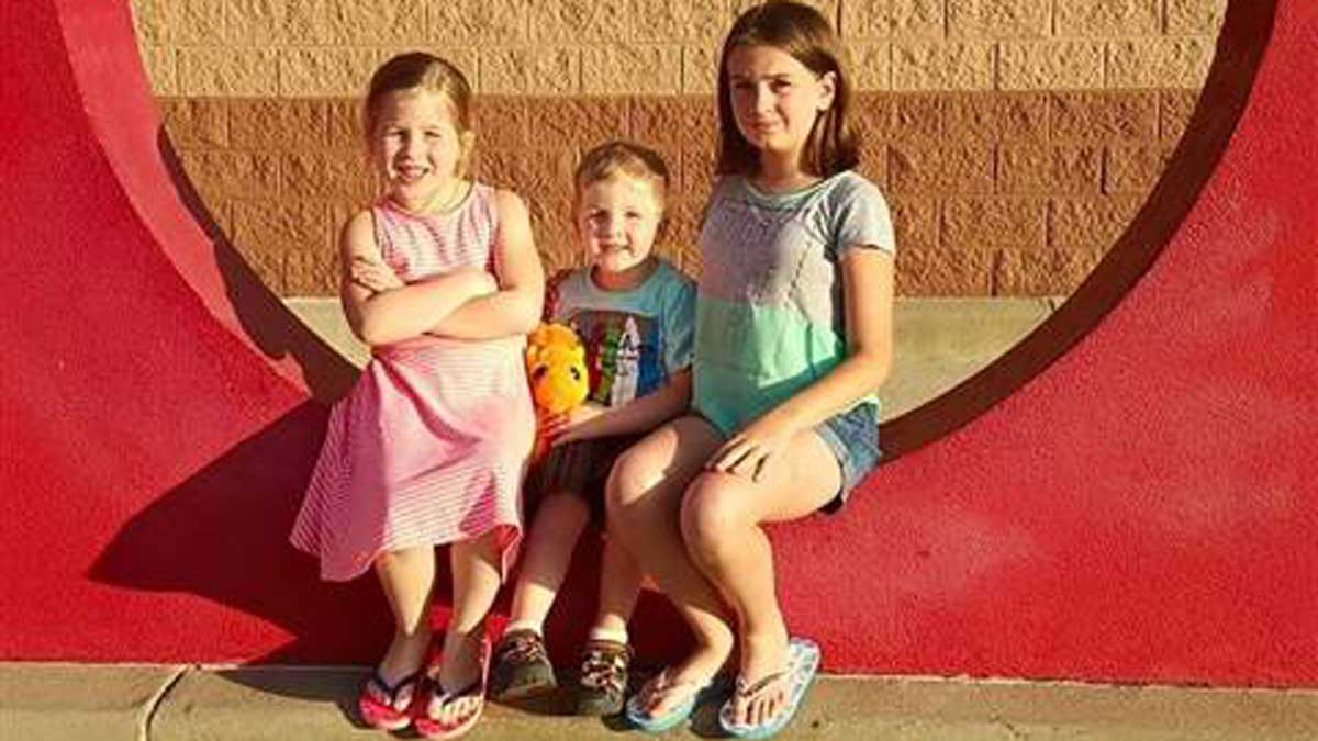 Carter Roberts and his two sisters before he was diagnosed with acute flaccid myelitis in July 2016.