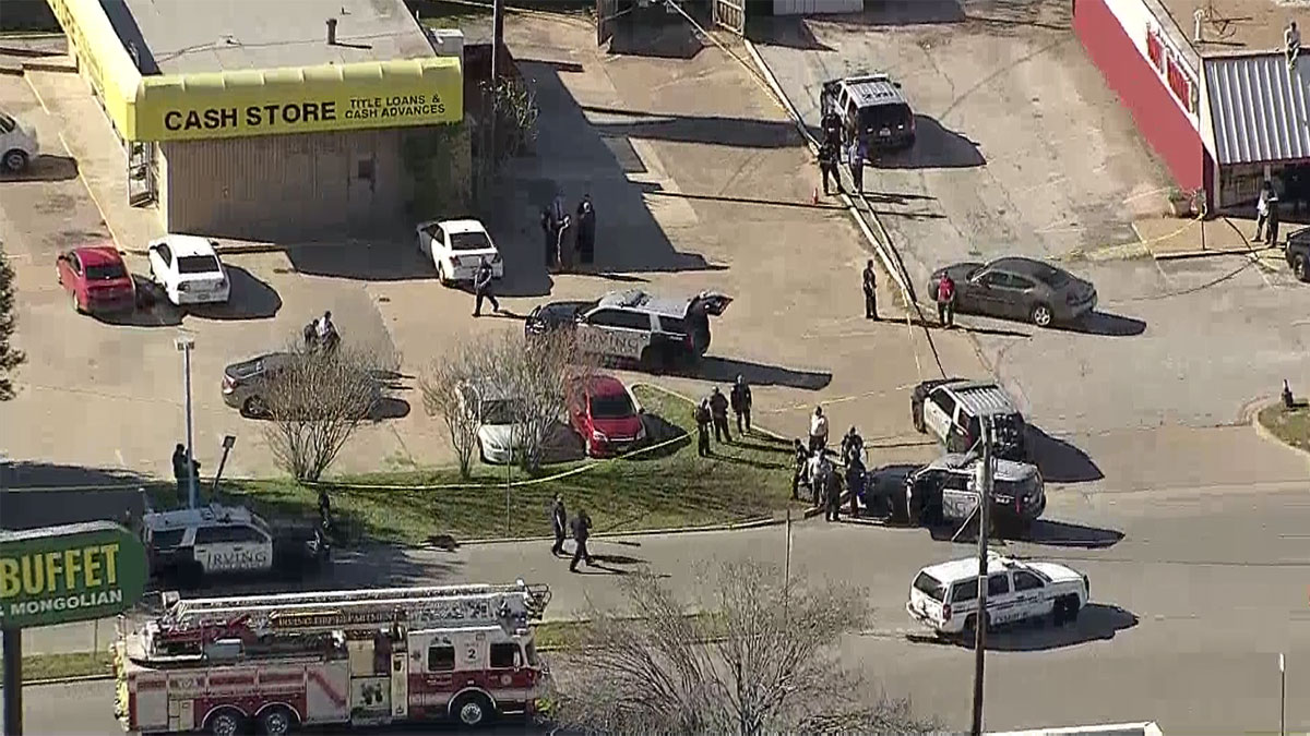 Irving police investigate a shooting at a Cash Store on Esters Road, Jan. 29, 2016.