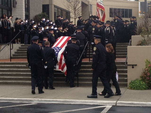The casket of BART Sgt. Tom Smith who was killed by friendly fire on Jan. 21 is taken into a Castro Valley church. Jan. 29, 2013