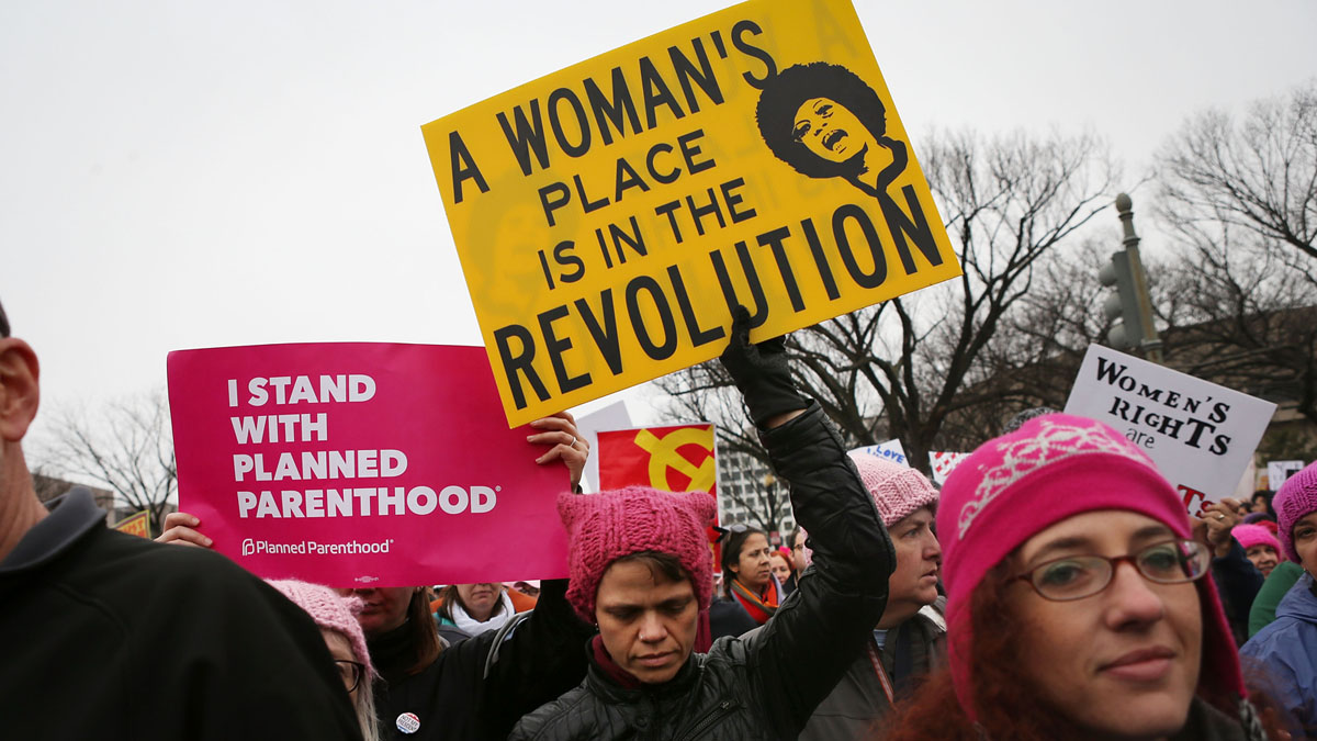 WASHINGTON, DC - JANUARY 21: Protesters march during the Women's March on Washington on January 21, 2017 in Washington, DC. Large crowds are attending the anti-Trump rally a day after U.S. President Donald Trump was sworn in as the 45th U.S. president. (Photo by Mario Tama/Getty Images)