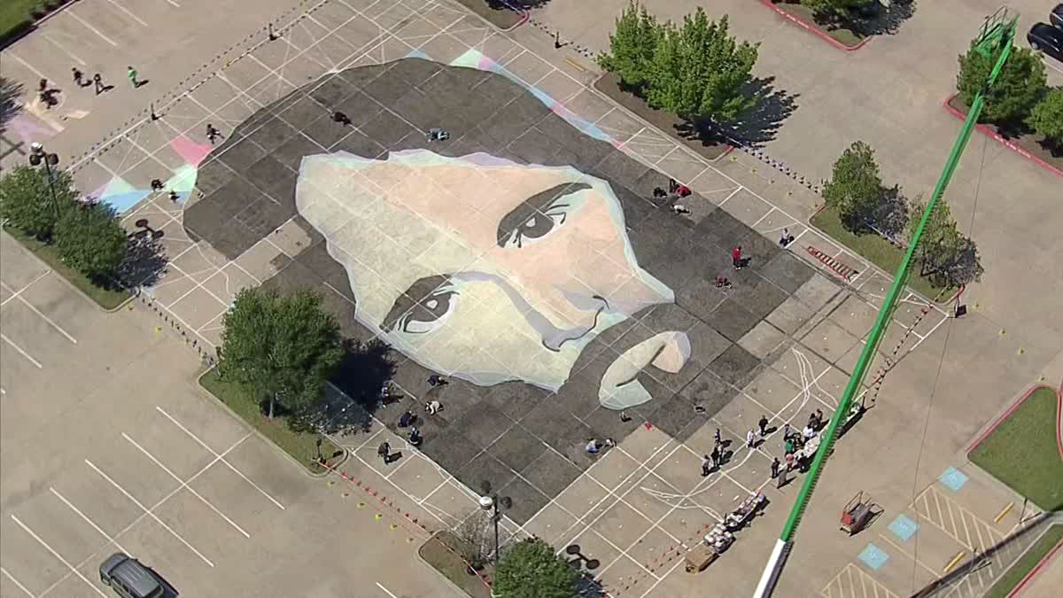Fellowship Church in Grapevine is attempting to set the world record for the largest chalk drawing.  Fellowship's effort is almost 17,000 square feet in size.