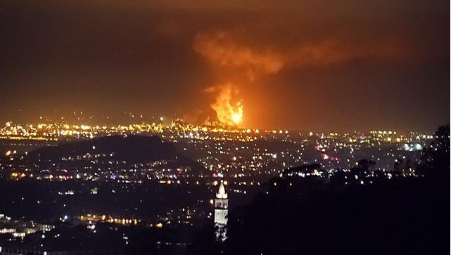 Photo of the Richmond Chevron refinery flares taken from the Oakland Hills.