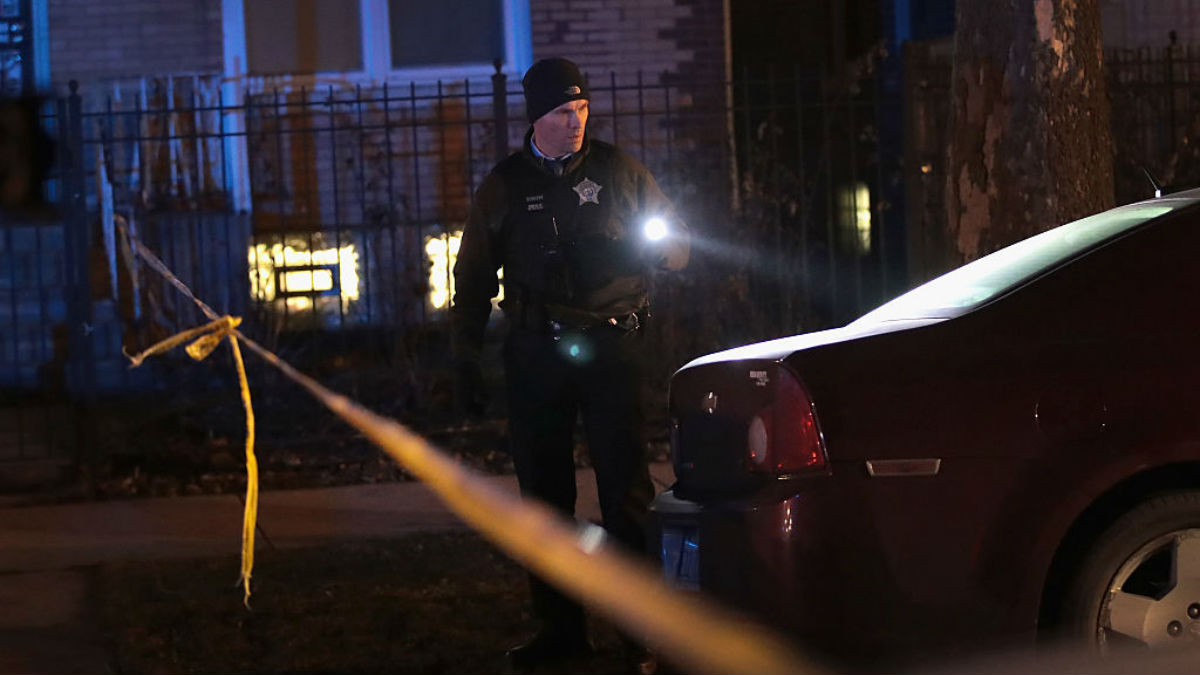 Police investigate the scene of a shooting where a 23-year-old woman was shot in the chest and hand and a 25-year-old man was shot in the leg on January 1, 2017, in Chicago, Illinois. The two were shot just before midnight on December 31, making them the last of more than 4,000 people shot in the city in 2016 and ending one of the most violent years in the city in two decades.