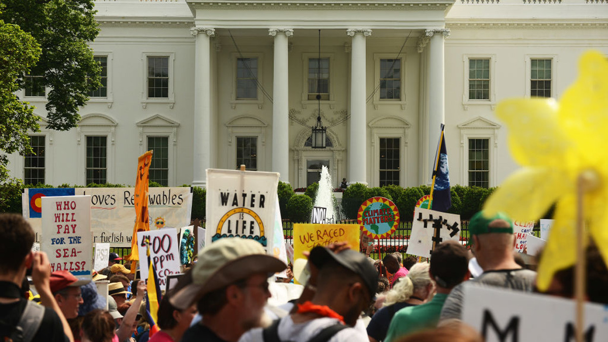 People march near the White House during the People's Climate Movement in Washington, D.C., April 29, 2017, to protest President Donald Trump's attack on the climate and the Environmental Protection Agency.