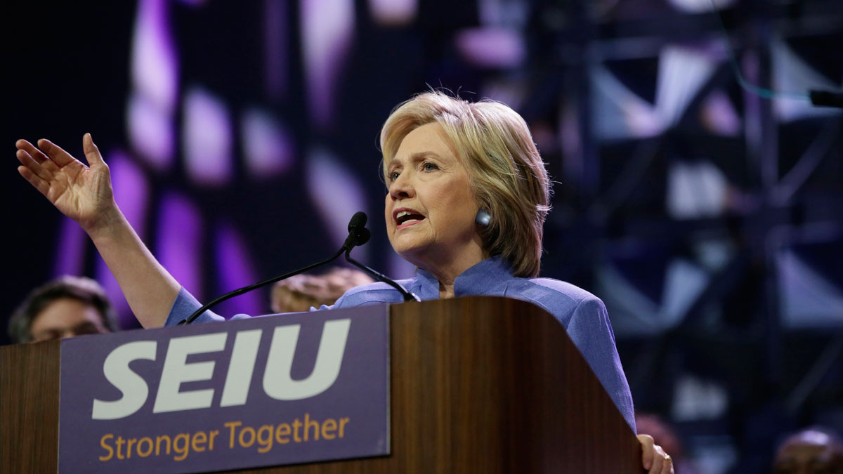 In this May 23, 2016, file photo, Hillary Clinton gestures while speaking to more than 3,000 Service Employees International Union members at the union's 2016 international convention in Detroit.