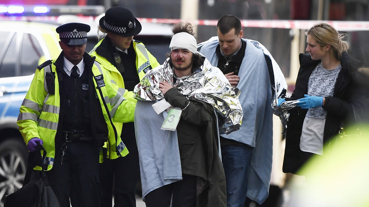 A member of the public is treated by emergency services near Westminster Bridge and the Houses of Parliament on March 22, 2017, in London, England. A police officer was stabbed near to the British Parliament and the alleged assailant shot by armed police. Scotland Yard report they have been called to an incident on Westminster Bridge where several people have been injured by a car.