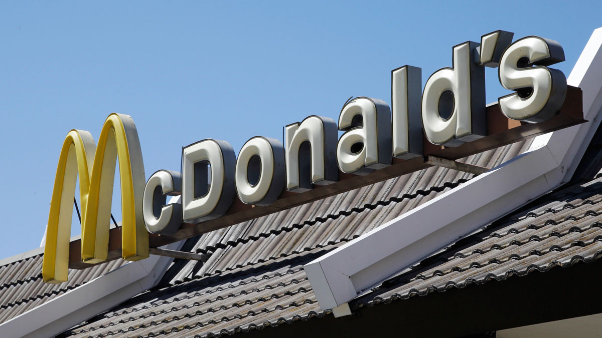 FILE - In this Friday, April 20, 2012, file photo, a McDonald's sign is shown at a McDonald's restaurant in East Palo Alto, Calif. McDonald's Corp., on Wednesday, Sept. 4, 2013, announced that a revamped version of its Dollar Menu that includes items priced at $5 could be launched nationally this year. (AP Photo/Paul Sakuma, File)
