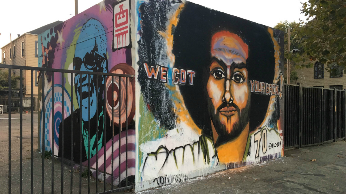 A muralist with the acronym FLC created a Colin Kaepernick mural at 22nd Street and Telegraph Avenue in Oakland.