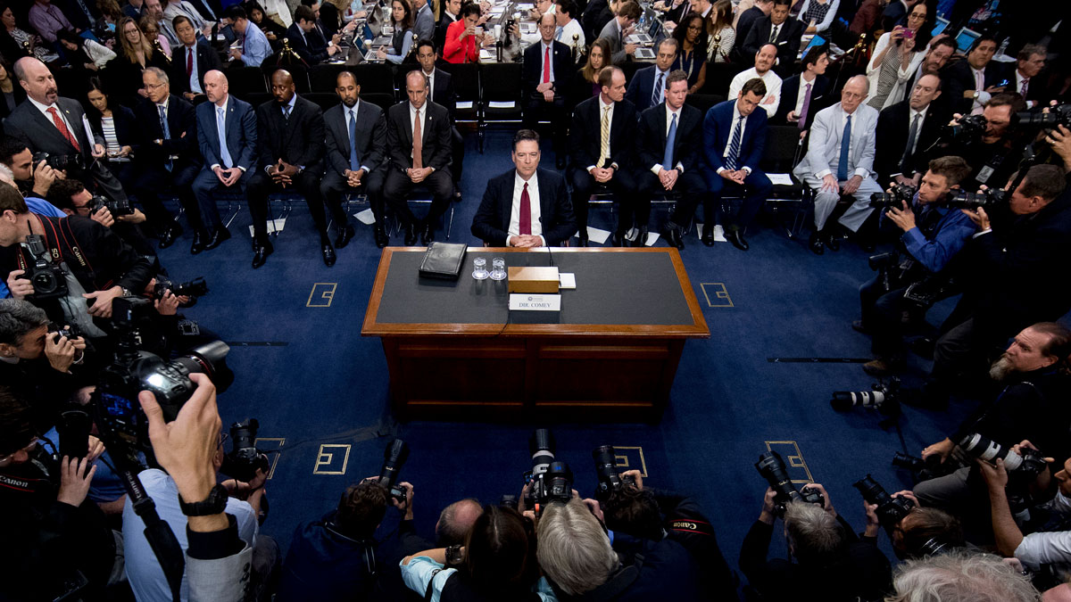 Former FBI Director James Comey takes his seat to testify at a Senate Intelligence Committee hearing on Capitol Hill, Thursday, June 8, 2017, in Washington. (AP Photo/Andrew Harnik)