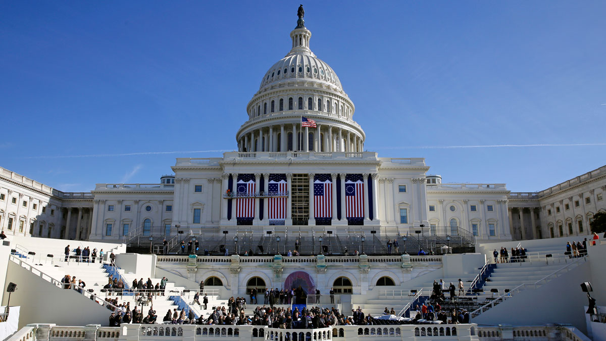 In this Jan. 15, 2016, photo, the U.S. Capitol frames the backdrop over the stage during a rehearsal of President-elect Donald Trump's swearing-in ceremony in Washington.