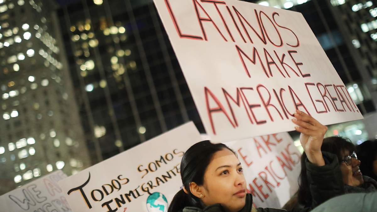 NEW YORK, NY - FEBRUARY 14: People, many of whom are undocumented, attend a Valentines Day rally organized by the New York Immigration Coalition called