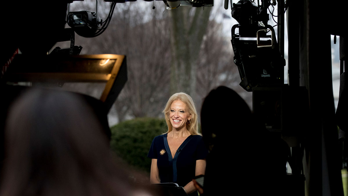 President Donald Trump's adviser Kellyanne Conway gets ready to speak on television outside the White House, Sunday, Jan. 22, 2017, in Washington.