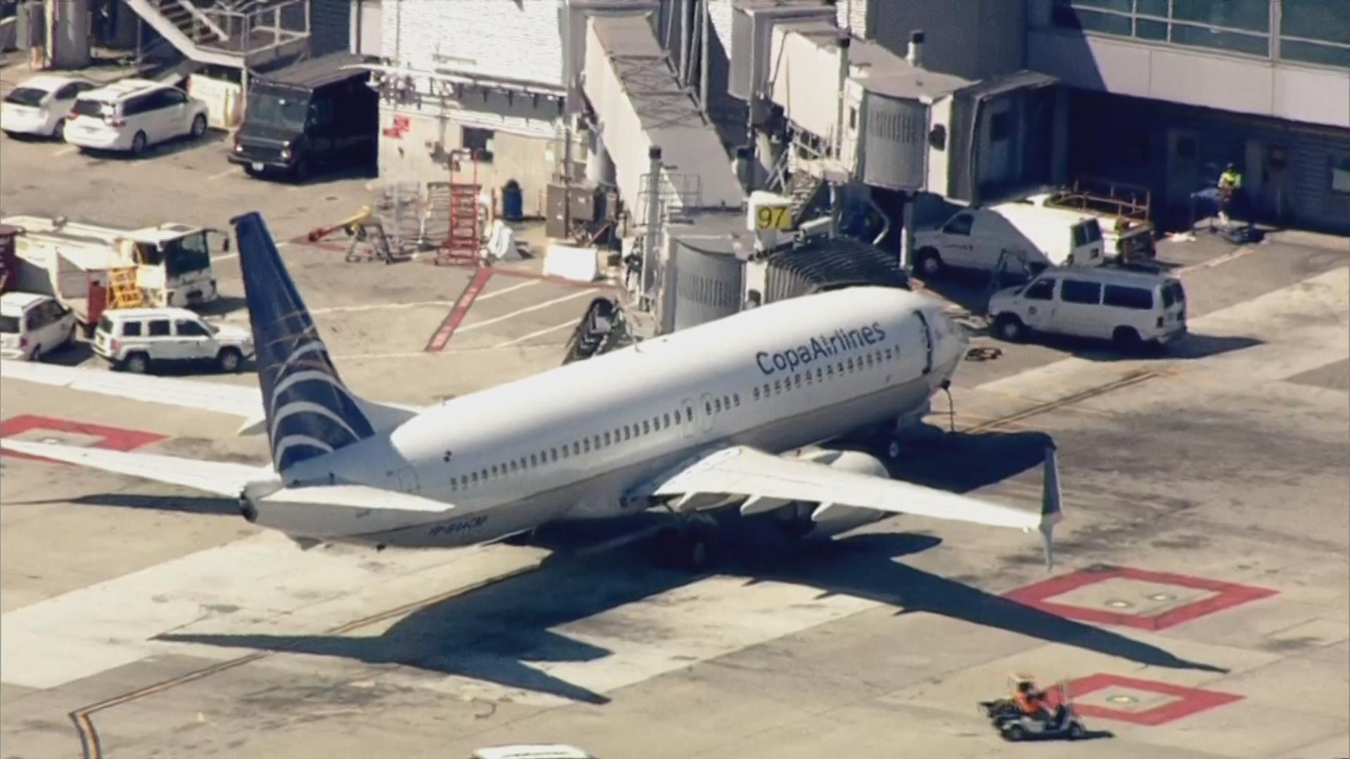 A teenager was detained Tuesday after opening an emergency exit and jumping from a plane after it landed at San Francisco International Airport.