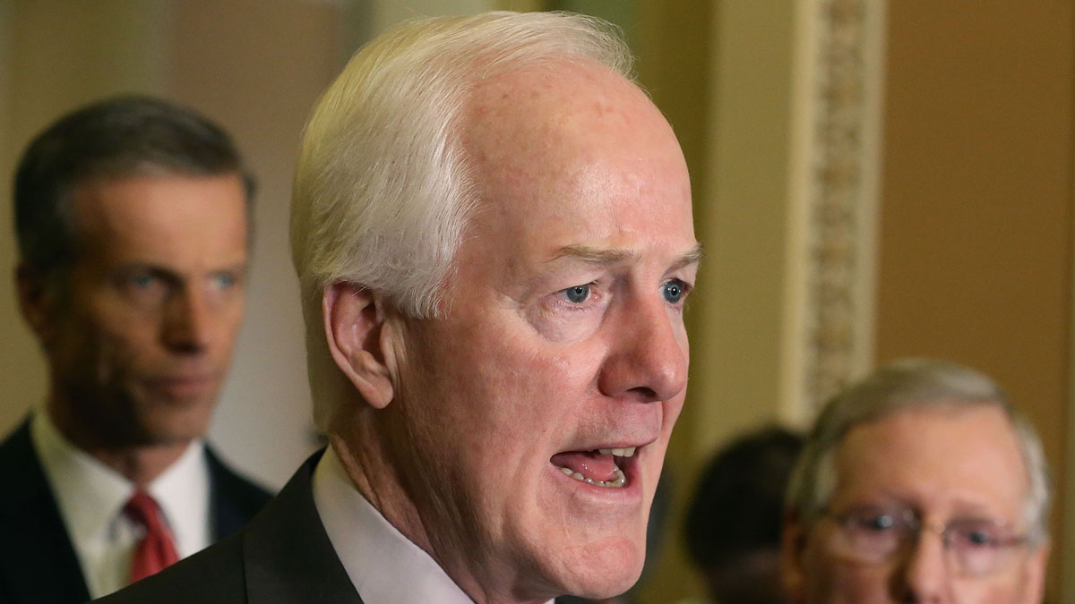 Sen. John Cornyn (R-TX) speaks to the media while flanked by Senate Majority Leader Mitch McConnell (R-KY) (R), and Sen. John Thune (R-SD) (L), on February 2, 2016 in Washington, DC.