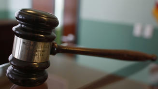 The office manager for a Greenwich oil company has pleaded guilty to embezzling $176,000 from the company.