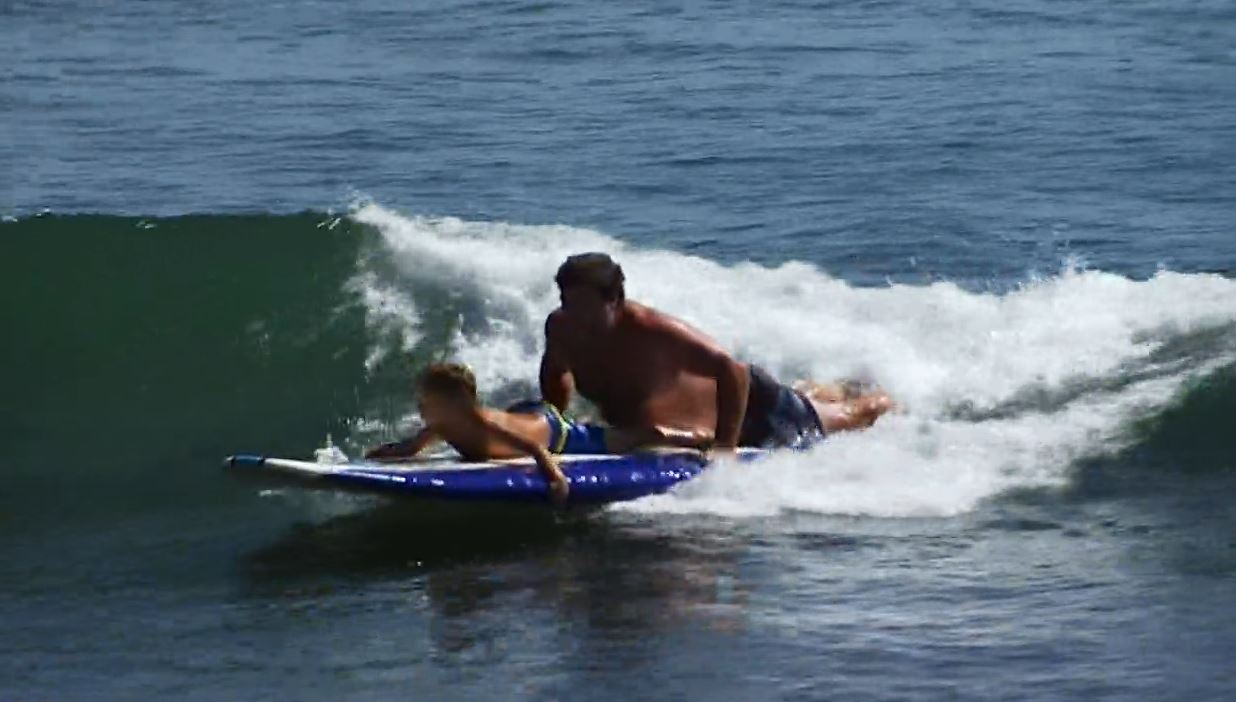 Children with cystic fibrosis hit the waves in Malibu with some of the world's top professional surfers on Saturday, Sept. 26, 2015.