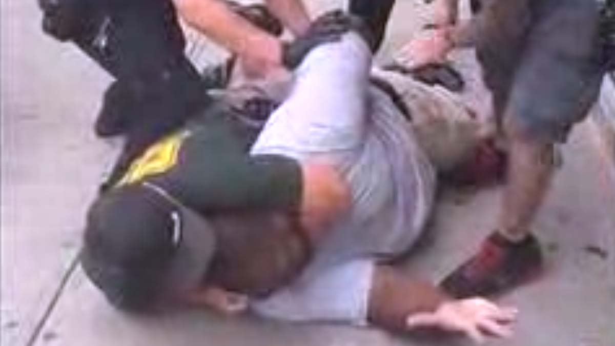 This still image from cellphone video of the arrest shows an arresting officer use what Police Commissioner William Bratton called a chokehold, a tactic banned by the NYPD,  to subdue Eric Garner in Staten Island on Thursday.