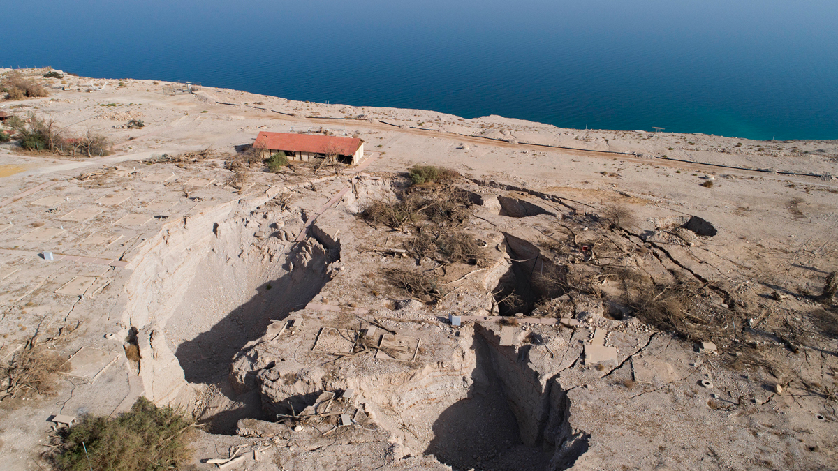 In this Nov. 28, 2017 photo, an aerial view shows sinkholes in the abandoned tourist resort of Ein Gedi on the Dead Sea shore.