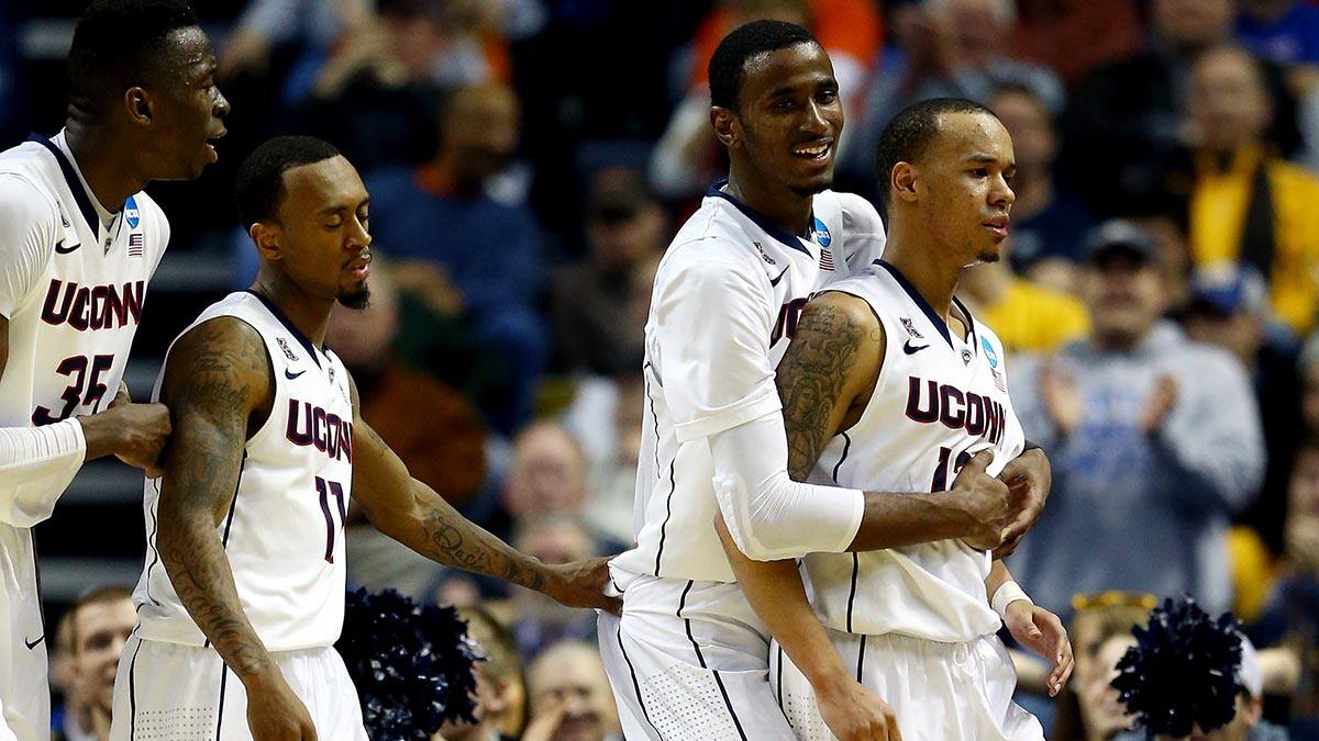 BUFFALO, NY - MARCH 20: DeAndre Daniels #2 celebrates with Shabazz Napier #13 of the Connecticut Huskies after defeating the Saint Joseph's Hawks 89-81 in the second round of the 2014 NCAA Men's Basketball Tournament at the First Niagara Center on March 20, 2014 in Buffalo, New York. (Photo by Elsa/Getty Images)