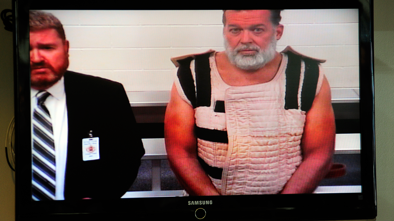 Colorado Springs shooting suspect, Robert Dear, right, appears via video before Judge Gilbert Martinez, with public defender Dan King, at the El Paso County Criminal Justice Center for this first court appearance, where he was told he faces first degree murder charges, on Monday, Nov. 30, 2015, in Colorado Springs, Colo.