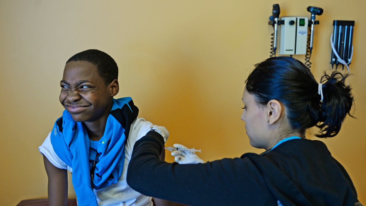 Kenneth Hurd, 12, gets a flu shoot from Jocelyn Martinez, Medical Assistant at Rocky Mountain Youth Clinic in Denver, January 02, 2014.